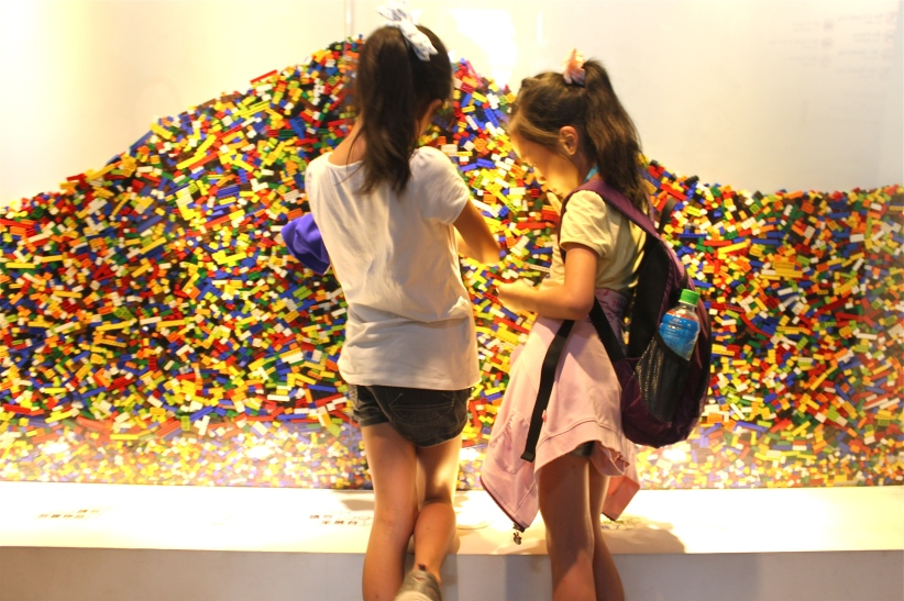 "Two young girls at Nathan Sawaya's ""The Art of the Brick"". Songshan Cultural and Creative Park."