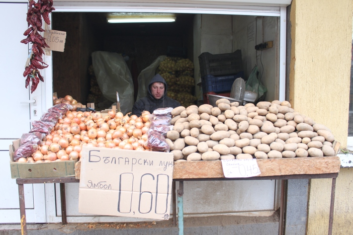 Man selling onions and potatoes in Sofia Bulgaria