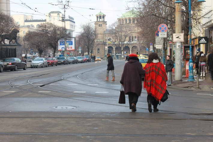 Two women crossing the street in Sofia Bulgaria