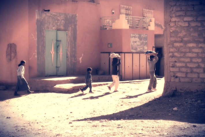 Kids walking home. Tinghir, Morocco.